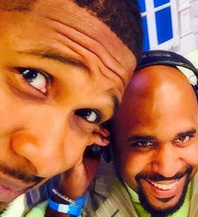 Photo of Usher and Cayman Kelly